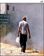 A settler in Hebron near the Jewish settlement of Kiryat Arba
