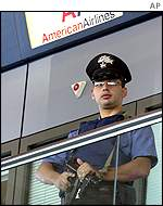 Italian policeman guards American Airlines site