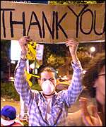 Resident with Thank You placard