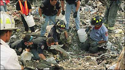 Rescue workers sift through the rubble (AP)