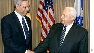 Colin Powell (left) and Ariel Sharon