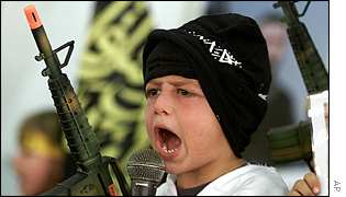 Child takes part in Islamic Jihad show honouring suicide bombers in Gaza City