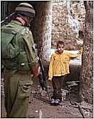 photo of Boy stopped by soldier at checkpoint