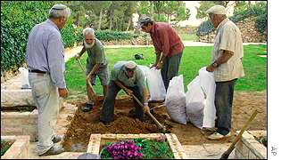 Grave diggers prepare a grave for Zeevi