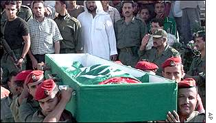 Palestinian policemen carry the coffin of one of four officers killed in Israeli reprisals Oct 3
