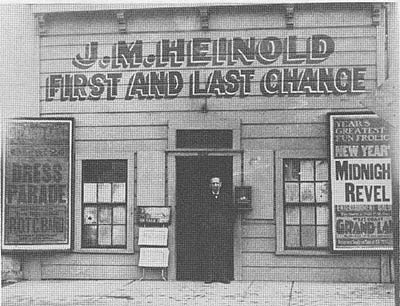 Johnny Heinold, in the doorway of his First and Last Chance Bar