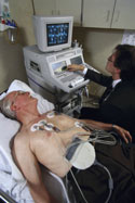 patient receiving echocardiogram, color photo
