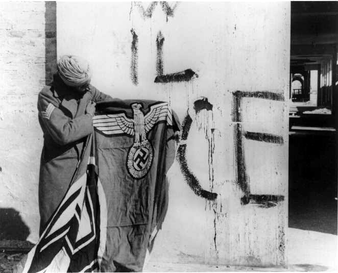 Sikh soldier with a captured Nazi flag