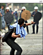 Stone throwing protester
