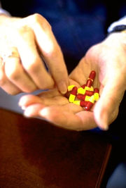 medications in hand, color photo