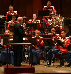 Renowned composer John Williams conducts 'The President's Own' United States Marine Band's 205th anniversary concert on July 12, 2003. Photo by: Marine Band