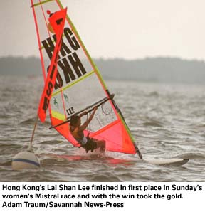 Lai Shan Lee crosses the finish line first in Sunday's race.