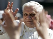 Pope Benedict XVI greets the crowd during the general audience in St. Peter's Square at the Vatican, Wednesday, April 27, 2005. Benedict XVI held the first general audience of his new pontificate Wednesday, pledging to work for reconciliation and peace. (AP Photo/Pier Paolo Cito)