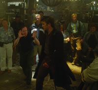"Whedon directs Fillion, who plays interplanetary smuggler Mal Reynolds.  There are no horses in ""Serenity,"" but the film does carry over many of the Western-evoking visual elements that distinguished ""Firefly,"" its television prequel."