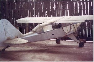 The Piper L-14 before restoration ...