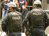 Montreal police tactical officers arrive on scene following the shooting in Montreal on Wednesday.