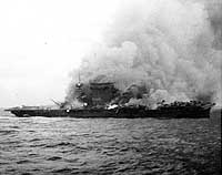 Photo # NH 51382:  USS Lexington burning and sinking after her crew abandoned ship, 8 May 1942