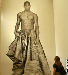 A Paolo Roversi photograph of a man in a skirt created by designer Jean-Paul Gaultier greets visitors.