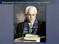 slide 11 photo of iraqi carrying documents found in home