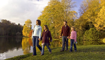 A family visiting a National Trust property in Autumn