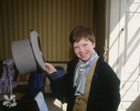 a boy in period costume at Belton House, Lincs