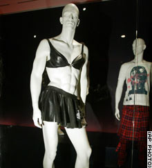 This rubber ensemble, designed by Andy Wilkes, was worn at the 2003 Grammy Awards by Adrian Young, a drummer for No Doubt.