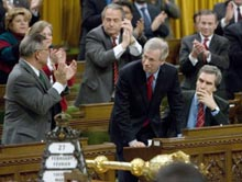 Opposition Leader Stéphane Dion receives a standing ovation Tuesday after voting against a bill to extend the anti-terrorism measures.