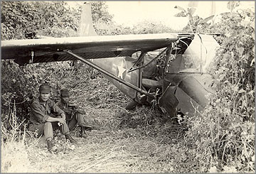 Recon plane crash into Vietnam War jungle area.