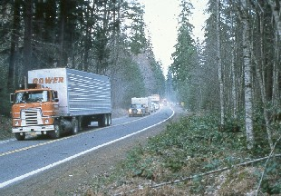 photo of moving vans retrieving USFS belongings from the Mount St. Helens Ranger Station south of the volcano