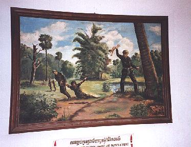 A child is beaten against a tree at Choeung Ek