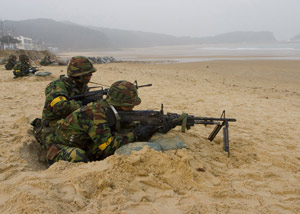 MALLIPO BEACH, Republic of Korea – Republic of Korea soldiers portray simulated aggressors during an amphibious landing exercise involving ROK Marines and the 31st Marine Expeditionary Unit here, March 29, as part of Exercise Foal Eagle 07. The amphibious landing was conducted to provide training for Republic of Korea and U.S. forces in the various aspects of planning, execution and integration of forces for defense-oriented operations to enhance readiness and the ability to defend the ROK against external aggression. Photo by: Cpl. Kamran Sadaghiani