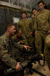 ABOARD USS JUNEAU – Lance Cpl. Ryan Graal, an assault man with the 31st Marine Expeditionary Unit, 3rd Marine Expeditionary Brigade, teaches Australian soldiers from 2nd Battalion, Royal Army Regiment, how to properly operate the MK-153 shoulder-launched multi-purpose assault weapon here, June 14. More than 20,000 U.S. and 12,000 Australian personnel will participate in Exercise Talisman Saber 2007, a combined and joint military training exercise set to enhance interoperability and regional stability. Photo by: Cpl. Kamran Sadaghiani
