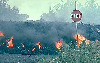 `A`a lava flow moves through intersection, Royal Gardens subdivision, Kilauea Volcano, Hawai`i