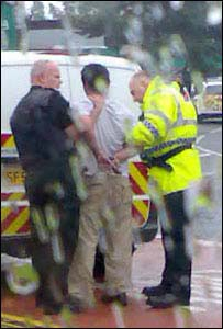 Man being arrested. Pic by Michael McRanor