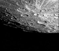 This Mariner 10 image of Mercury shows a gray, rocky and heavily-cratered world. You can see the curvature of the planet.
