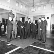 Delegates to the 1969 Five Power Defence Conference gathered in Kings Hall, Parliament House include (left to right): Prime Minister Holyoake of New Zealand, Minister for Defence Allen Fairhall, Prime Minister John Gorton, British Secretary of State for Defence Denis Healey and Tun Razak of Malaysia. NAA: A1200, L81806