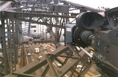 A camera from ABC Resource Hire filming atop the Sydney Harbour Bridge