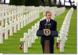President George W. Bush gives a Memorial Day at the Normandy American Cemetery at Normandy Beach in France on May 27, 2002. White House photo by Paul Morse.
