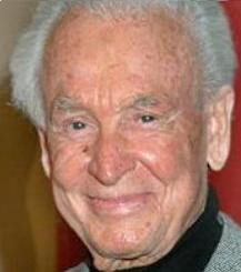 Sweet Baby Jesus save us...it's BOB BARKER without his make-up!!!