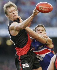 Mark Bolton contests for the footy under pressure.