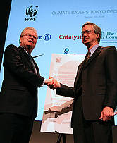 Business setting an example : Sony chair and CEO Sir Howard Stringer presents The Tokyo Declaration to WWF International Director-General James Leape.
