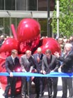 Artist Koons (L) helped cut the ceremonial ribbon