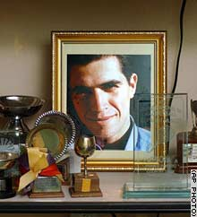 A photo of John Freddy Arellan sits in his grandmother's Bogota house.