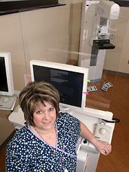 Nurse Nancy Liber standing with a digital mammogram machine at the Barrets Cancer Center in Cincinnati.