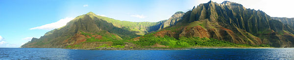 A view of the Nā Pali coastline from the ocean.  It is part of the Nā Pali Coast State Park which encompasses 6,175 acres (20 km²) of land and is located on the northwest side of Kauaʻi.