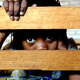 A Child looks through a bench in East Rand, Johannesburg. Photo by Chris Harris of The Times