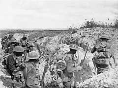 Australian soldiers moving along a communication trench at Mont St Quentin, France, 1 September 1918. [AWM E03139]