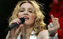 Madonna at Live Aid concert. Holy Cows on Telegraph TV asks how can we dance while others suffer?