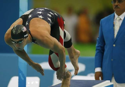 Michael Phelps leaps out of the starting block in the Men's 200-meter Freestyle on Tuesday.
