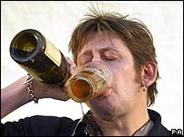 Shane MacGowan takes refreshment at a concert